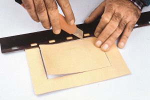 come realizzare un portafoto in cuoio